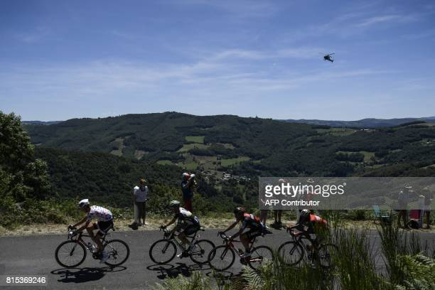 France's Warren Barguil wearing the best climber's polka dot jersey Belgium's Serge Pauwels Italy's Damiano Caruso and Ethiopia's Tsgabu Grmay ride...