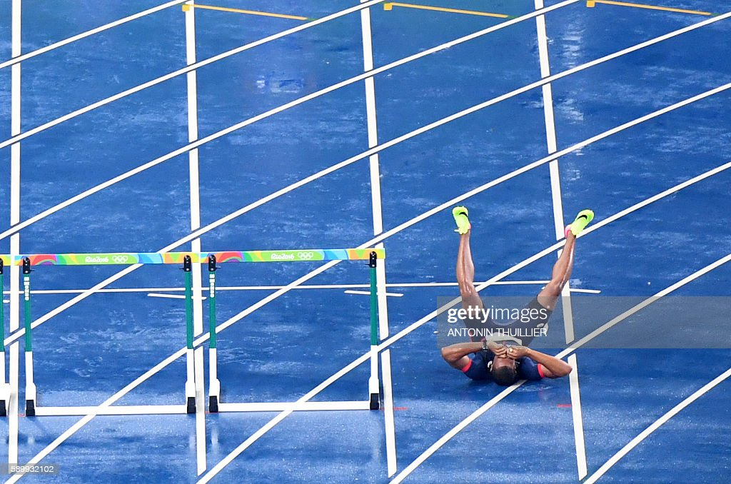 TOPSHOT France's Wilhem Belocian reacts following his disqualification for false start during the Men's 110m Hurdles Round 1 of the athletics event...