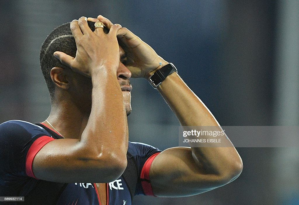 France's Wilhem Belocian reacts following his disqualification for false start during the Men's 110m Hurdles Round 1 of the athletics event at the...
