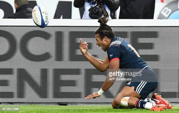 France's wing Teddy Thomas celebrates after scoring a try during the friendly rugby union international Test match between France and New Zealand All...