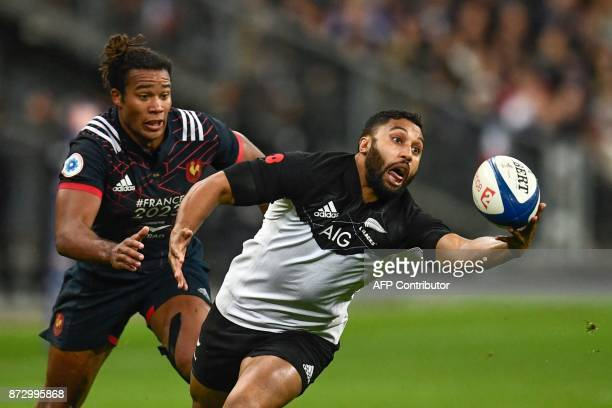 TOPSHOT France's wing Teddy Thomas looks on as New Zealand's flanker Vaea Fifita catches the ball during the friendly rugby union international Test...