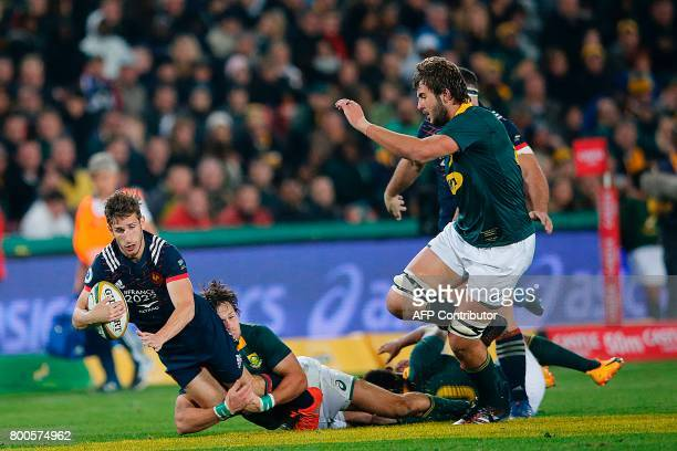 France's wing Vincent Rattez is tackled during the third rugby union Test match between South Africa and France at The Emirates Ellis Park Stadium in...