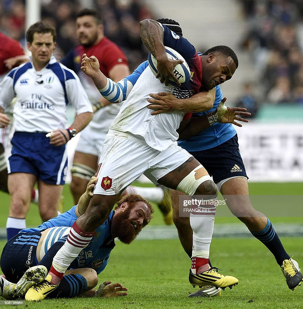 France's wing Virimi Vakatawa is tackled by Italy's scrumhalf Edoardo Gori and Italy's centre Gonzalo Garcia during the Six Nations international...
