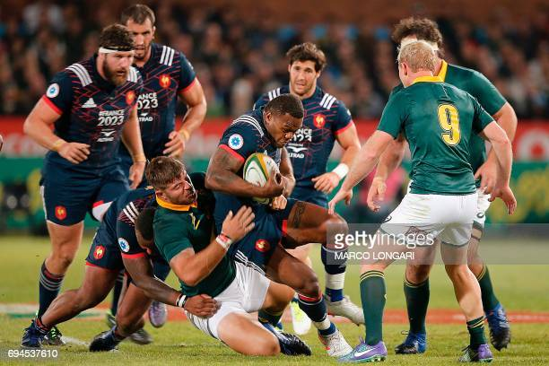 France's wing Virimi Vakatawa is tackled by South Africa's hooker Malcolm Marx during the first rugby union Test match between South Africa and...