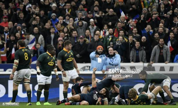 France's wing Yoann Huget and teammates celebrate a try during the friendly rugby union international Test match between France and South Africa's...