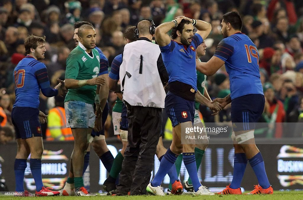France's wing Yoann Huget (2R) reacts at the final whistle during the Six Nations international rugby union match between Ireland and France at Aviva Stadium in Dublin, Ireland on February 14, 2015.