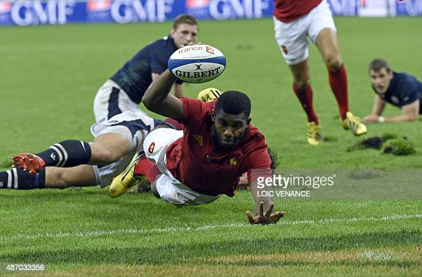 France's winger Noa Nakaitaci scores a try during the rugby union test match between France and Scotland at the Stade de France in SaintDenis north...