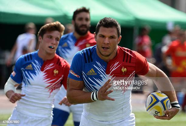 France's winger Remy Grosso runs with the ball during the Rugby Seven's Europe Grand Prix Series 2015 match at the Luzhniki Stadium in Moscow on June...
