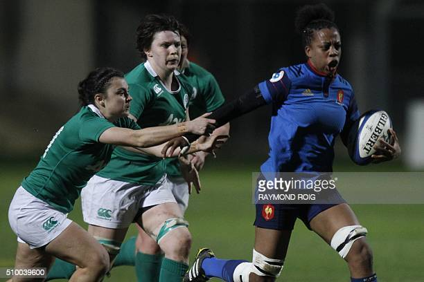 France's winger Romane Menager runs with the ball during the Women's Six Nations rugby union match France vs Ireland on February 13 2016 in Perpignan...
