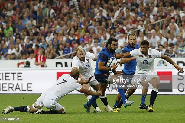 Frances winger Yoann Huget runs to score a try during the Rugby Union test match between France and England at the Stade de France stadium in...