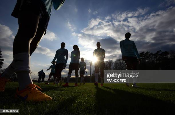 France's women's team players take part in a training session in Clairefontaine en Yvelines southwest of Paris on April 6 ahead of the friendly...