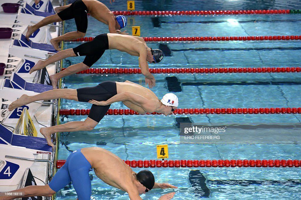 France's Yannick Agnel (2nd bottom) takes the start of his men's 400m freestyle heat during the European Short Course Swimming Championships on November 22, 2012 in Chartres. AFP PHOTO / ERIC FEFERBERG