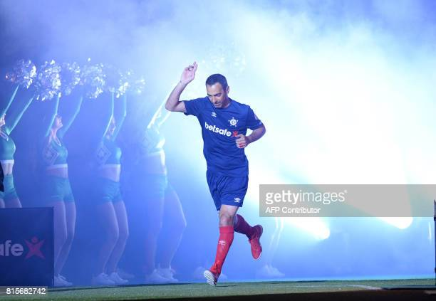 France's Youri Djorkaeff gestures as he comes on for the Star Sixes final football match between France and Denmark at the O2 Arena in London on July...
