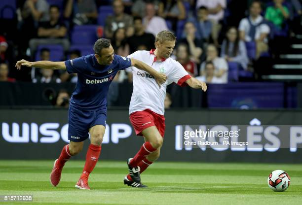 France's Youri Djorkaeff is challenged by Denmark's Martin Jorgensen during the final of the Star Sixes Tournament at The O2 Arena London PRESS...