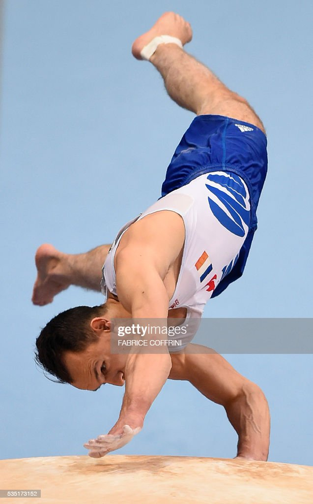 Frances Zachari Hrimeche performs during the Mens Vault competition of the European Artistic Gymnastics Championships 2016 in Bern, Switzerland on May 29, 2016. / AFP / FABRICE