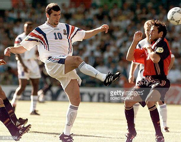 France's Zedine Zidane and Spain's Martinez Luis Enrique in action during a European soccer championship match between Spain and France in Leeds...