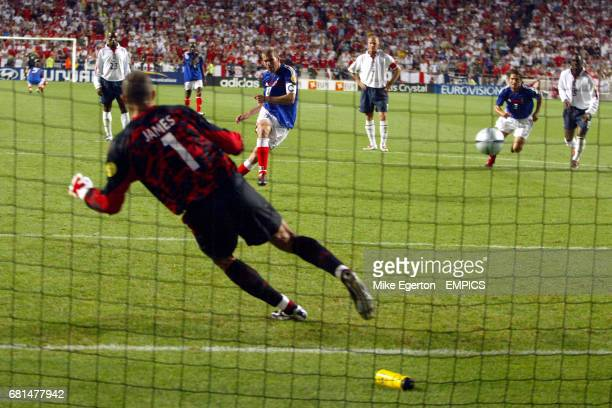 France's Zinedine Zidane scores from a penalty to win the game for his team in the final moments