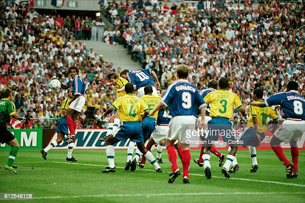 France's Zinedine Zidane scoring the second goal during the 1998 FIFA World Cup final against Brazil France won 30 | Location Saint Denis France