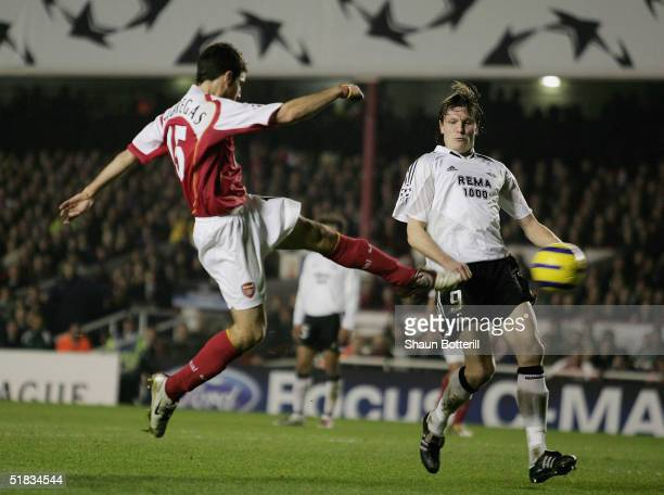 Francesc Fabregas of Arsenal scores Arsenal's third goal during the Champions League Group E match between Arsenal and Rosenborg at Highbury on...