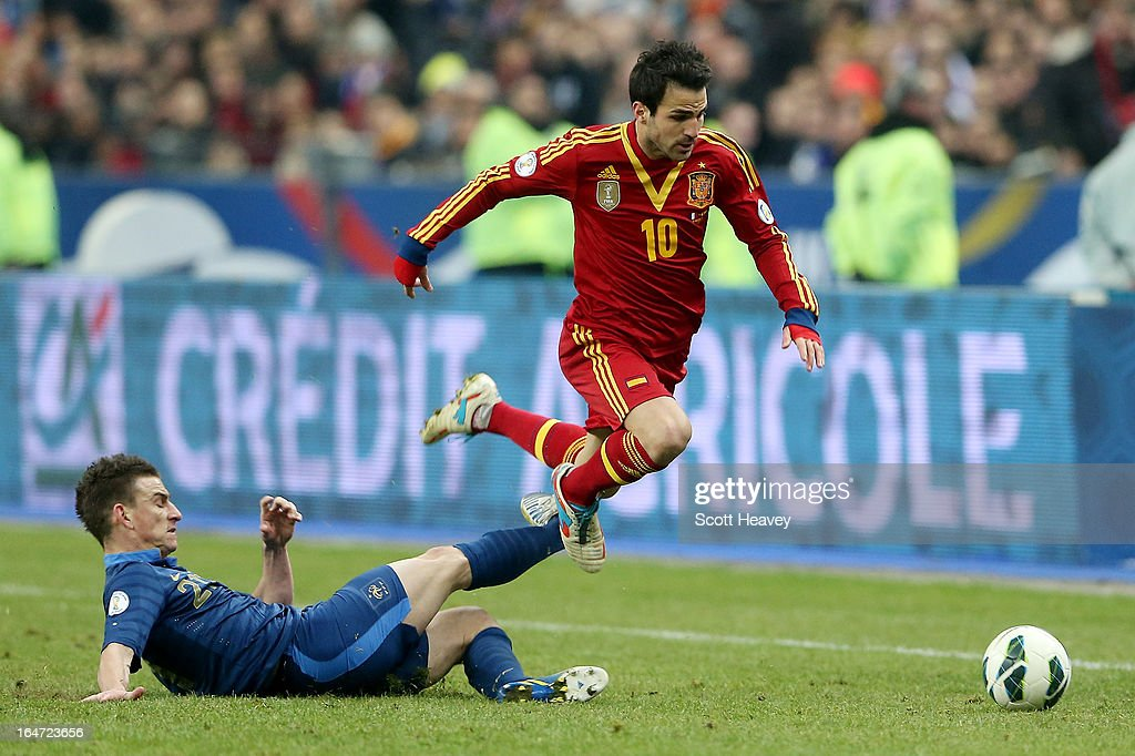 Francesc Fabregas of Spain is brought down by Laurent Koscielny of France during a FIFA 2014 World Cup Qualifier between France and Spain at Stade de France on March 26, 2013 in Paris, France.