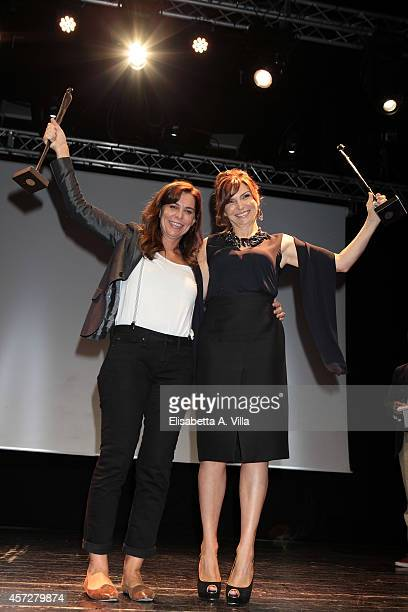 Francesca Comencini and Maria Pia Calzone pose with the award during the Premio Afrodite 2014 at Capitol Club on October 15 2014 in Rome Italy