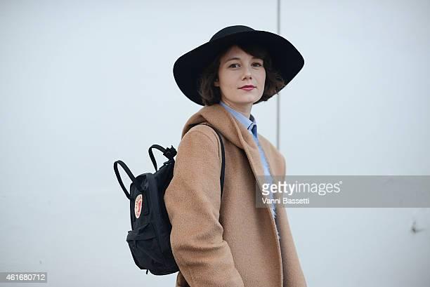 Francesca Crippa poses wearing a Max Mara coat Marella sweater and Fjall Raven bag on January 17 2015 in Milan Italy