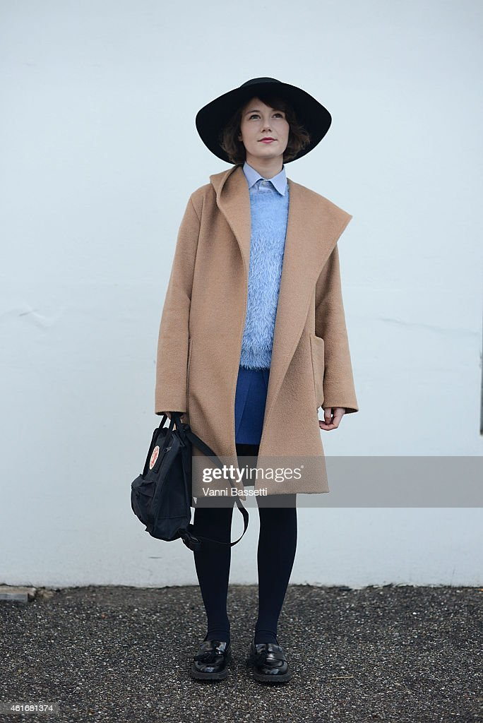 Francesca Crippa poses wearing a Max Mara coat Marella sweater Fjall Raven bag and Urban Outfitters shoes on January 17 2015 in Milan Italy