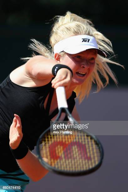 Francesca Jones of Great Britain serves during girls singles first round match against Mai Hontama of Japan on day nine of the 2017 French Open at...