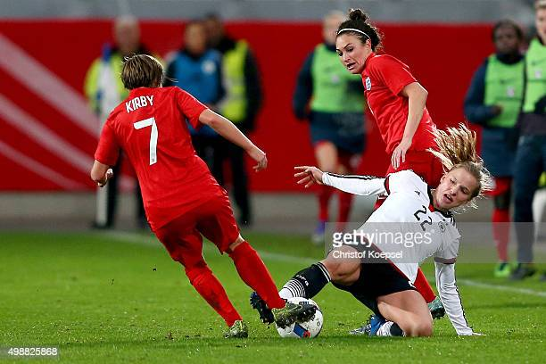 Francesca Kirby of England and Jodie Taylor of England challenge Tabea Kemme of Germany during the Women's International Friendly match between...