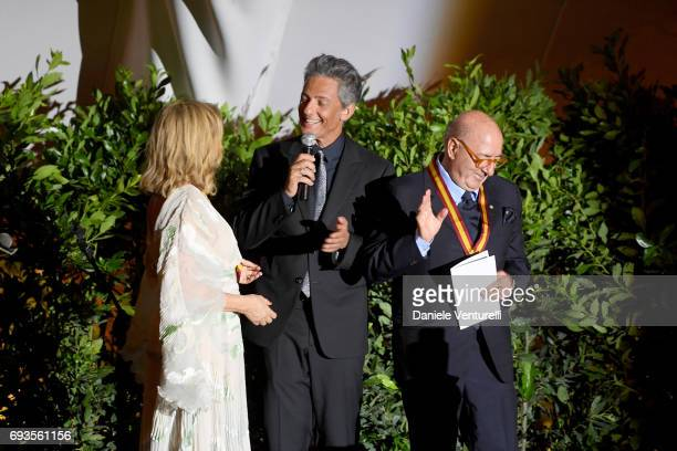 Francesca Lo Schiavo Dante Ferretti and Rosario Fiorello on the stage of McKim Medal Gala at Villa Aurelia on June 7 2017 in Rome Italy