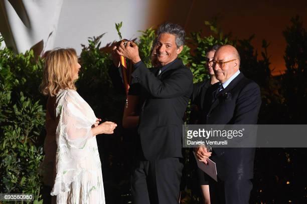 Francesca Lo Schiavo is awarded by Rosario Fiorello on the stage of McKim Medal Gala at Villa Aurelia on June 7 2017 in Rome Italy