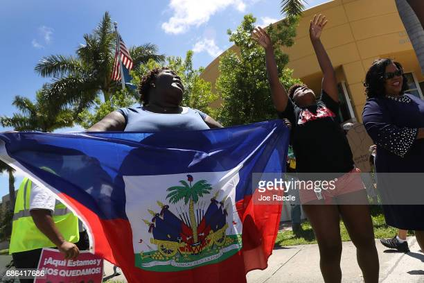 Francesca Menes and others protest in front of the United States Citizenship and Immigration Services office in Broward county to urge the Department...