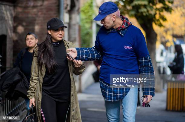 Francesca Molteni and Ecce Homo wearing Balenciaga tshirt and cap checked button shirt is seen during Tbilisi Fashion Week Spring/Summer 2018 on...