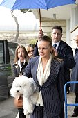 Francesca Pascale the girlfriend of former Italian Prime Minister arrives at the Fiumicino Airport near Rome on March 25 2014 Italy's former prime...