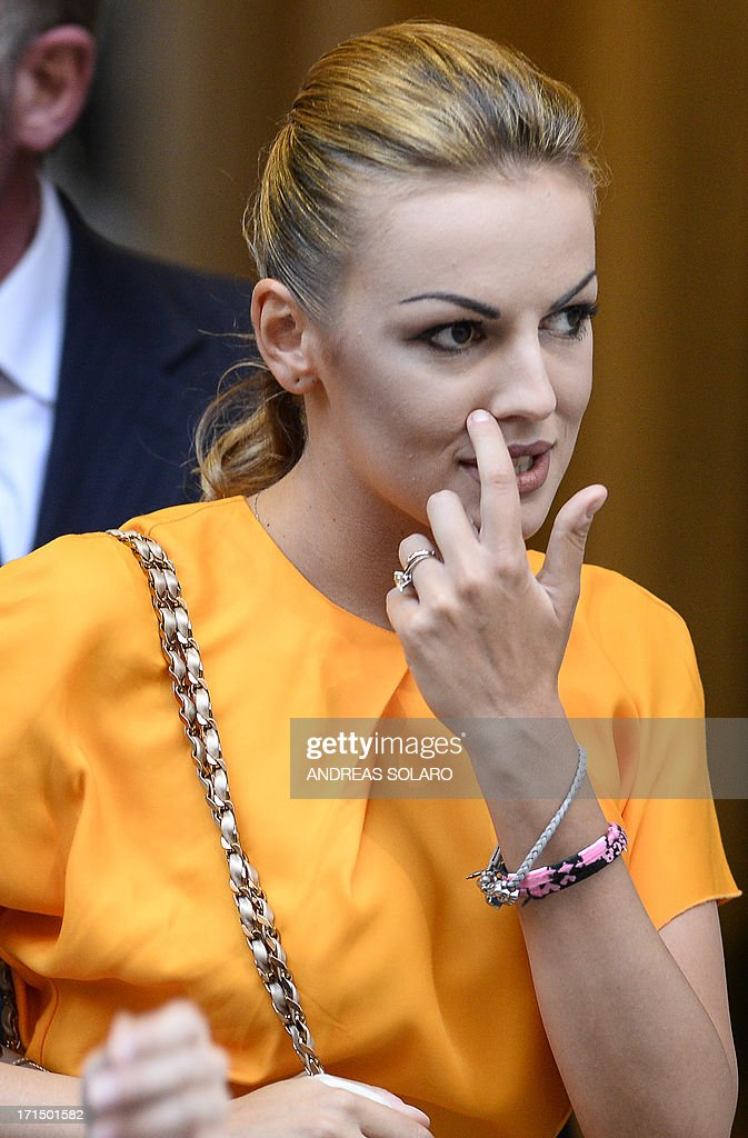 Francesca Pascale (C), the girlfriend of former Italian prime minister Silvio Berlusconi, leaves Palazzo Grazioli (Berlusconi's residence) on June 25, 2013 in Rome. Silvio Berlusconi's furious reaction to a conviction for paying for sex with an underage prostitute suggests a belligerent centre-right will intensify pressure on the coalition government to favour its policies, particularly concerning the hot-button issue of tax, analysts said Tuesday. Political observers had warned a guilty verdict could provoke the capricious former premier into pulling support from Enrico Letta's grand coalition, for failing to offer him legal protection. SOLARO