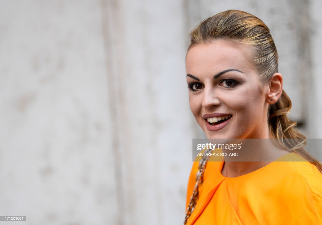Francesca Pascale, the girlfriend of former Italian prime minister Silvio Berlusconi, leaves Palazzo Grazioli (Berlusconi's residence) on June 25, 2013 in Rome. Silvio Berlusconi's furious reaction to a conviction for paying for sex with an underage prostitute suggests a belligerent centre-right will intensify pressure on the coalition government to favour its policies, particularly concerning the hot-button issue of tax, analysts said Tuesday. Political observers had warned a guilty verdict could provoke the capricious former premier into pulling support from Enrico Letta's grand coalition, for failing to offer him legal protection. SOLARO