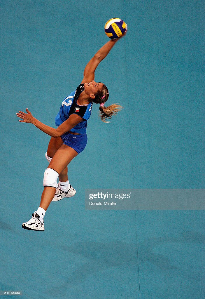 Francesca Piccinini of Italy serves the ball during her team's 23 loss to Cuba in the women's indoor Volleyball quarterfinal match on August 24 2004...