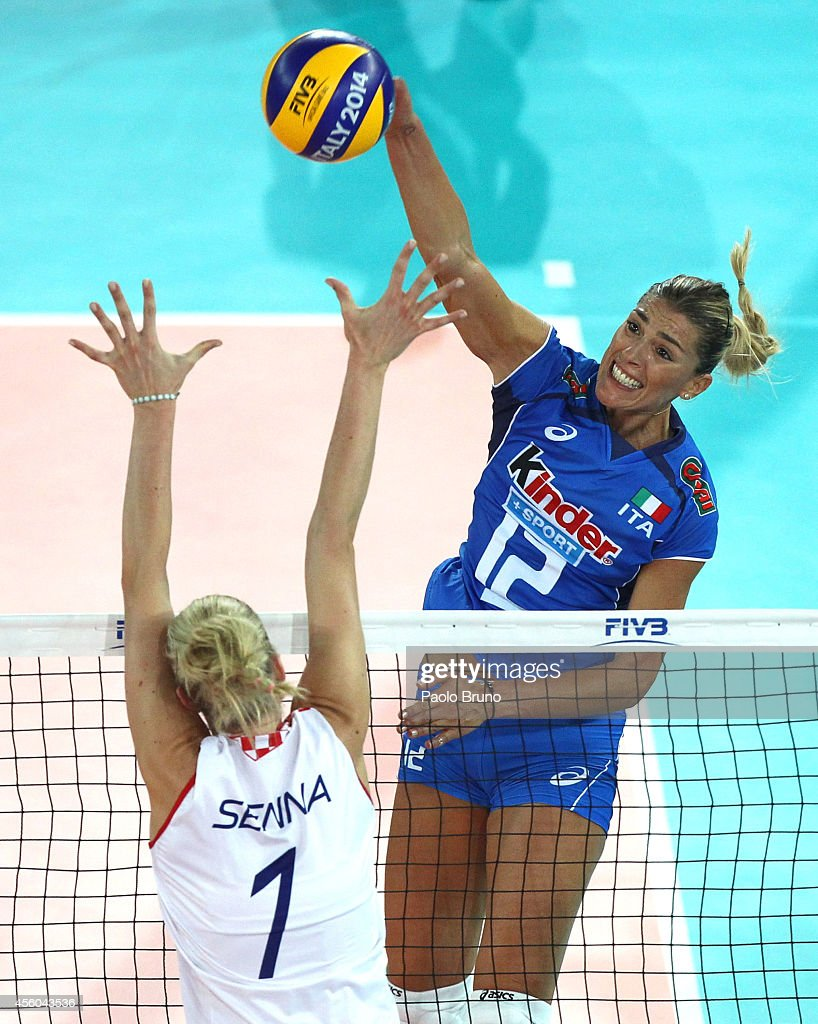Francesca Piccinini of Italy spikes the ball as Bernarda Cutuk of Croatia blocks during the FIVB Women's World Championship pool A match between...