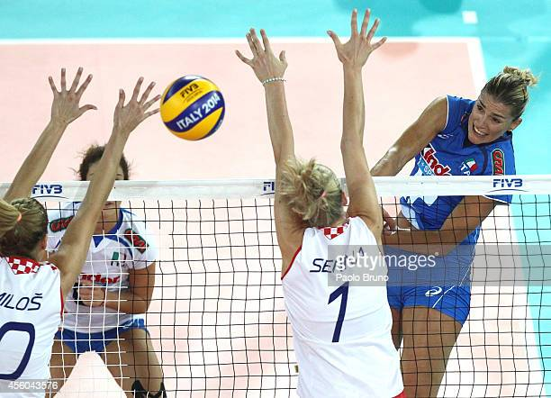 Francesca Piccinini of Italy spikes the ball as Croatia player block during the FIVB Women's World Championship pool A match between Croatia and...