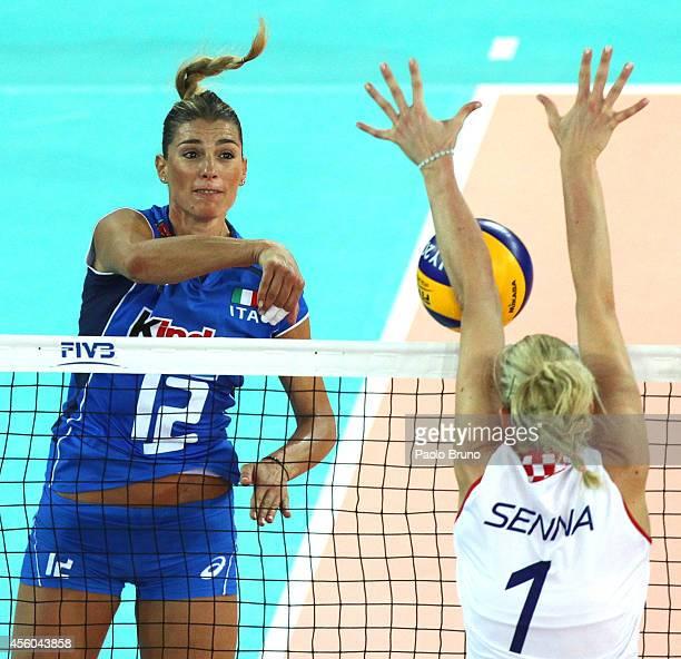 Francesca Piccinini of Italy spikes the ball as Usic Senna of Croatia blocks during the FIVB Women's World Championship pool A match between Croatia...