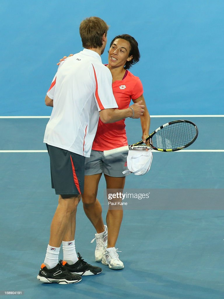 <a gi-track='captionPersonalityLinkClicked' href=/galleries/search?phrase=Francesca+Schiavone&family=editorial&specificpeople=171396 ng-click='$event.stopPropagation()'>Francesca Schiavone</a> and <a gi-track='captionPersonalityLinkClicked' href=/galleries/search?phrase=Andreas+Seppi&family=editorial&specificpeople=228727 ng-click='$event.stopPropagation()'>Andreas Seppi</a> of Italy celebrate winning the mixed doubles match against Ashleigh Barty and Bernard Tomic of Australia during day six of the Hopman Cup at Perth Arena on January 3, 2013 in Perth, Australia.