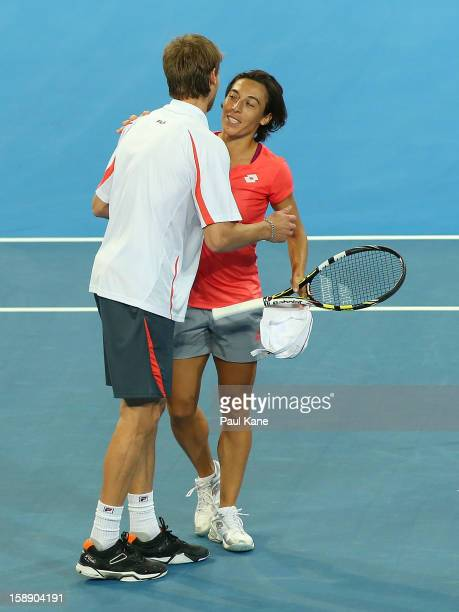 Francesca Schiavone and Andreas Seppi of Italy celebrate winning the mixed doubles match against Ashleigh Barty and Bernard Tomic of Australia during...