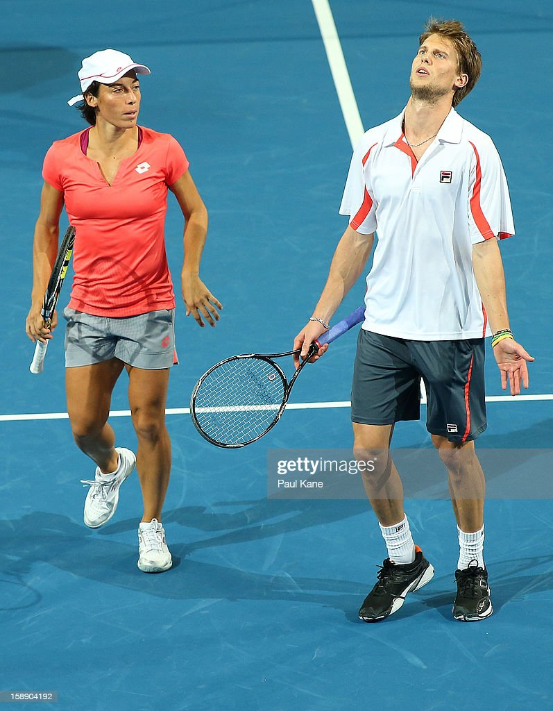 Francesca Schiavone and Andreas Seppi of Italy react to missing a shout in the mixed doubles match against Ashleigh Barty and Bernard Tomic of Australia during day six of the Hopman Cup at Perth Arena on January 3, 2013 in Perth, Australia.