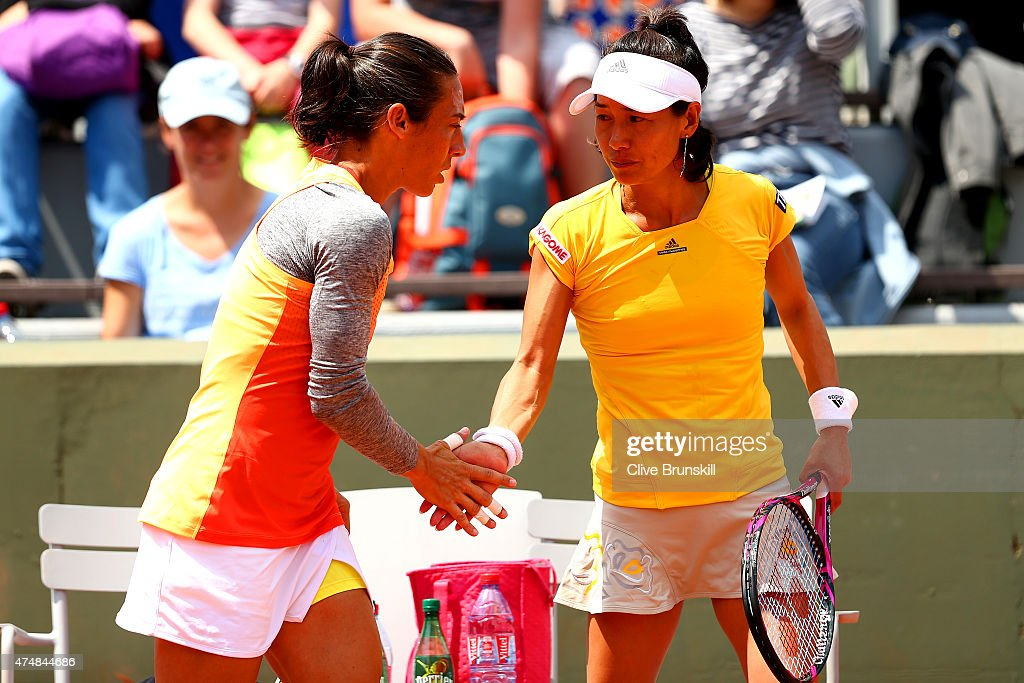 Francesca Schiavone of Italy celebrates a point with Kimiko DateKrumm of Japan in their Women's Doubles match against Petra Cetkovska of Czech...