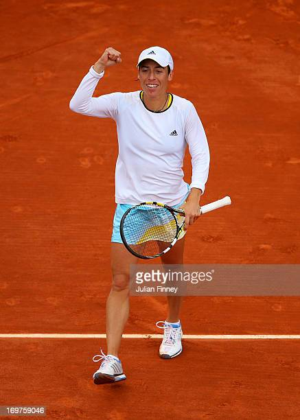 Francesca Schiavone of Italy celebrates match point in her Women's Singles match against Marion Bartoli of France during day seven of the French Open...