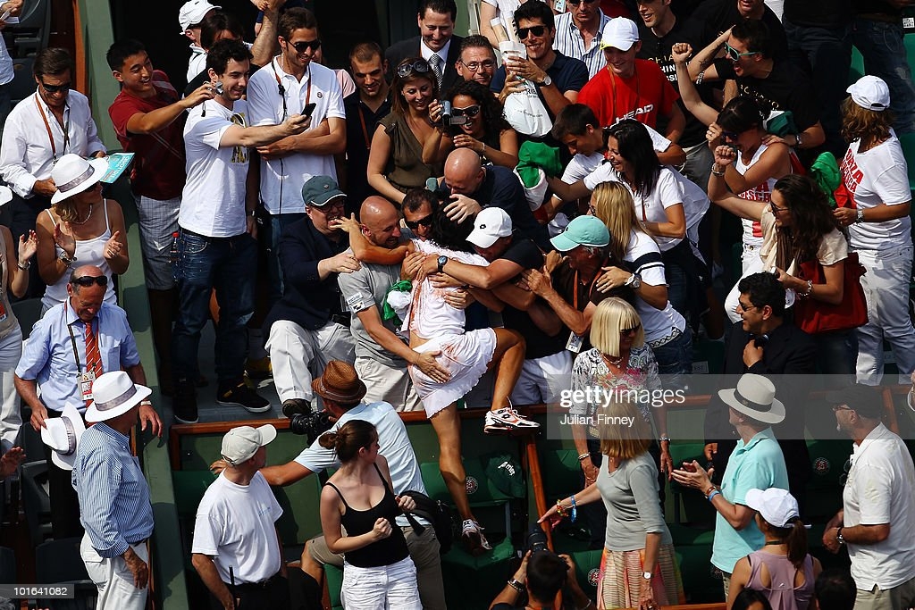 Francesca Schiavone of Italy celebrates with her team after winning the women's singles final match between Francesca Schiavone of Italy and Samantha Stosur of Australia on day fourteen of the French Open at Roland Garros on June 5, 2010 in Paris, France.