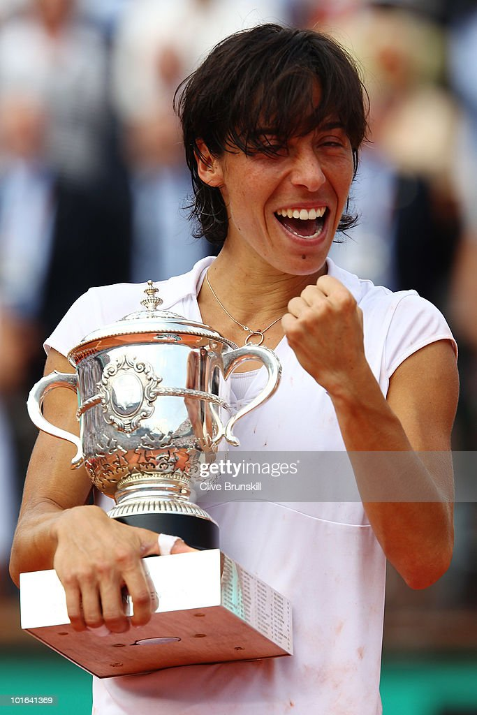 Francesca Schiavone of Italy celebrates with the trophy after winning the women's singles final match between Francesca Schiavone of Italy and Samantha Stosur of Australia on day fourteen of the French Open at Roland Garros on June 5, 2010 in Paris, France.