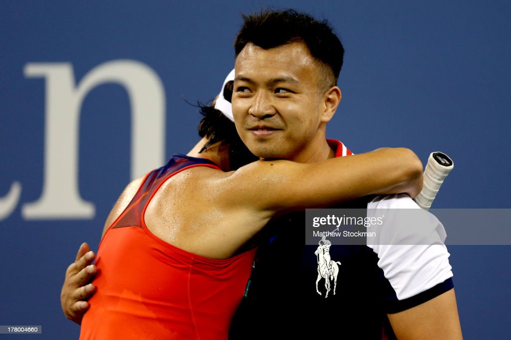 Francesca Schiavone of Italy hugs a ball boy during her first round women's singles match against Serena Williams of the United States of America on Day One of the 2013 US Open at USTA Billie Jean King National Tennis Center on August 26, 2013 in the Flushing neighborhood of the Queens borough of New York City.