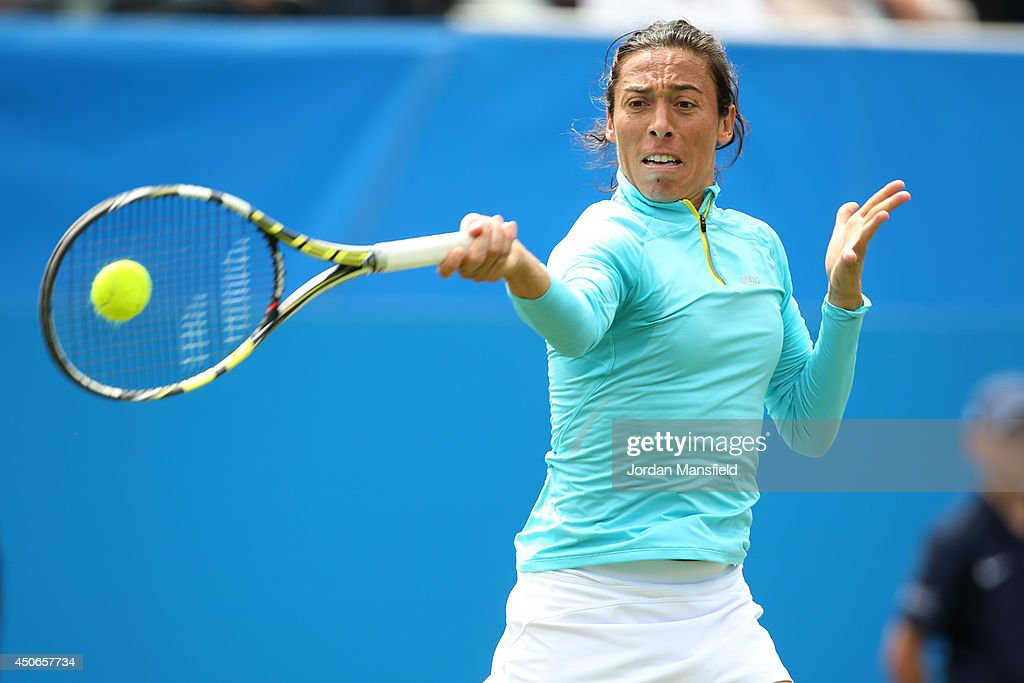 <a gi-track='captionPersonalityLinkClicked' href=/galleries/search?phrase=Francesca+Schiavone&family=editorial&specificpeople=171396 ng-click='$event.stopPropagation()'>Francesca Schiavone</a> of Italy in action against Yuliya Beygelzimer of Ukraine during their Women's Singles third round qualifying match on day two of the Aegon International at Devonshire Park on June 15, 2014 in Eastbourne, England.