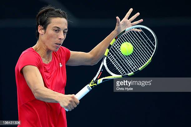 Francesca Schiavone of Italy plays a backhand against Jelena Jankovic of Serbia during day five of the 2012 Brisbane International at Pat Rafter...